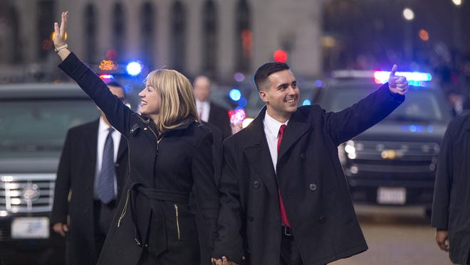 Mike Pence's son Michael and his wife wave to the crowds during the Inaugural Parade on Pennsylvania Avenue, Washington, D.C., Saturday, Jan. 20, 2017.