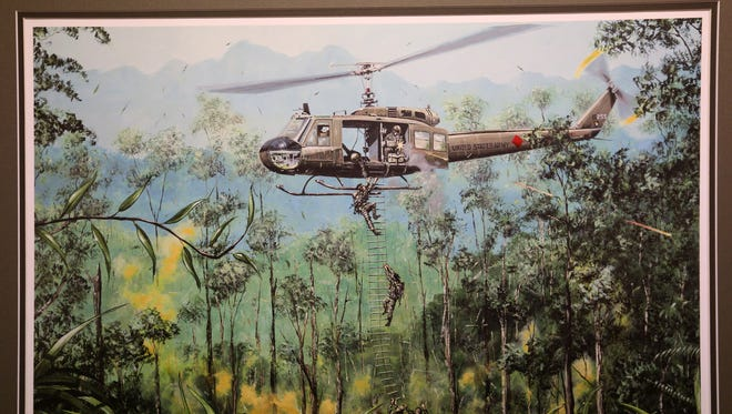 A customized limited-edition print by aviation artist Joe Kline depicts what Army Warrant Officer Gerald Woods' last mission would have been like. Woods' helicopter was shot down during an extraction mission Feb. 18, 1971 near the Vietnam-Laos border.