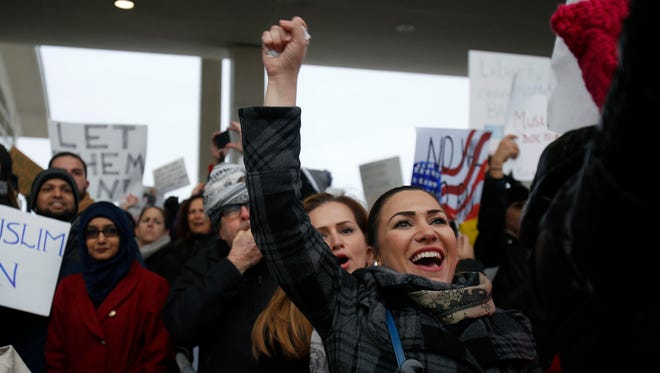 Community members and organizers gather outside the McNamara Terminal at Detroit Metropolitan Airport on Sunday, Jan. 29, 2017 in Romulus to speak out against the recent executive order on immigration signed by President Donald Trump.