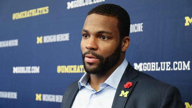 Former Michigan receiver Braylon Edwards talks football with reporters after the Signing of the Stars event at the Crisler Center in Ann Arbor on Wednesday, Feb. 1, 2017.