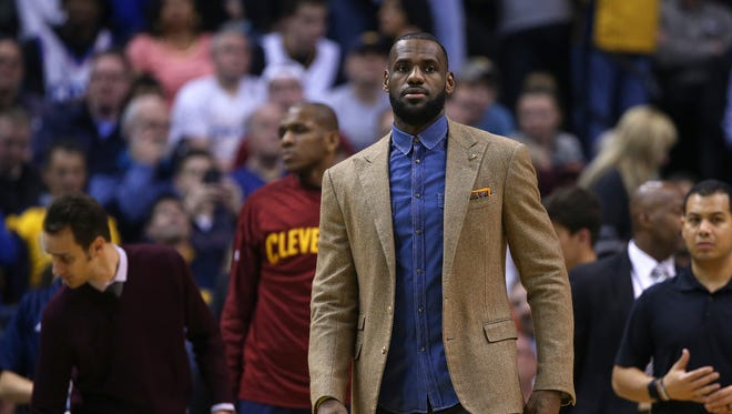 Cleveland Cavaliers forward LeBron James (23) sat the bench during the game against the Pacers, Bankers Life Fieldhouse, Indianapolis, Wednesday, April 6, 2016.