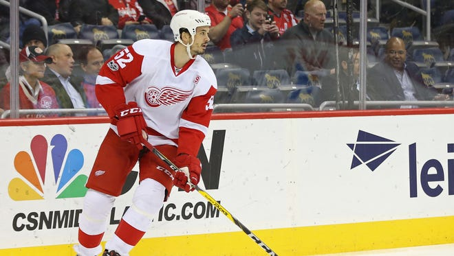 Detroit Red Wings defenseman Jonathan Ericsson skates with the puck against the Washington Capitals on Feb. 9, 2017.