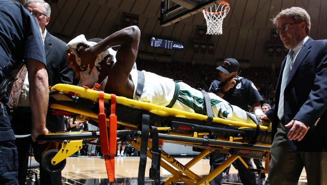 Feb 18, 2017; West Lafayette, IN, USA; Michigan State Spartans guard Eron Harris, after injuring his right knee, is taken off on a stretcher against the Purdue Boilermakers at Mackey Arena.