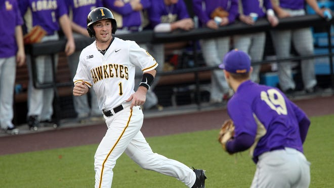 Iowa's Mason McCoy runs in a score during the Hawkeyes' game against Loras College at Duane Banks Field on Wednesday, Feb. 22, 2017.