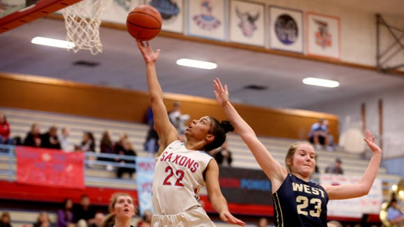 South Salem's Evina Westbrook (22) stretches for the basket past West Albany's Georgia Smith (23) in the first half of the West Albany vs. South Salem girl's basketball game at South Salem High School on Friday, Jan. 20, 2017. South Salem won the game 75-41.