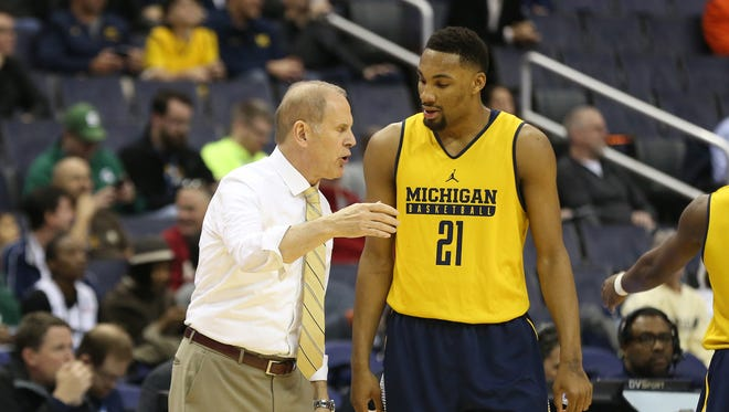 Michigan coach John Beilein talks to guard Zak Irvin in the first half of U-M's 75-55 win over Illinois during the Big Ten tournament Thursday, March 9, 2017 in Washington.