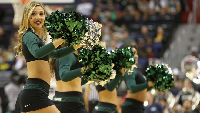 Mar 9, 2017; Washington, DC, USA; Members of the Michigan State Spartans dance team on the court during a time-out against the Penn State Nittany Lions at the Big Ten Conference tournament.