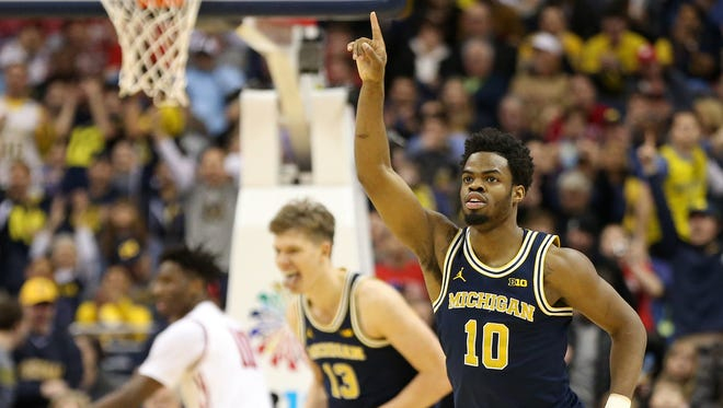 Mar 12, 2017; Washington, DC, USA; Michigan Wolverines guard Derrick Walton Jr. celebrates against the Wisconsin Badgers in the first half of U-M's 71-56 win in the Big Ten Conference tournament championship game at Verizon Center.