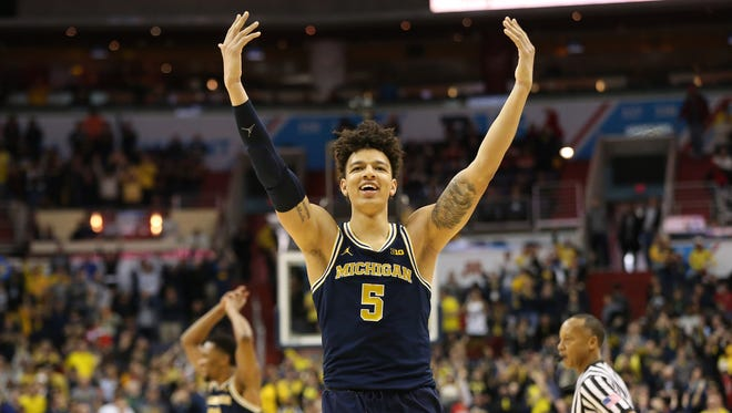 Mar 12, 2017; Washington, DC, USA; Michigan Wolverines forward D.J. Wilson (5) celebrates in the closing seconds of the second half against the Wisconsin Badgers during the Big Ten Conference Tournament championship game at Verizon Center. The Wolverines won 71-56.