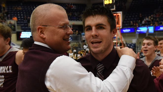 Pikeville Schools superintendent Jerry Green (left) and Pikeville coach Elisha Justice celebrate after Pikeville's win over Johnson Central in the 15th Region Tournament championship game on March 6.