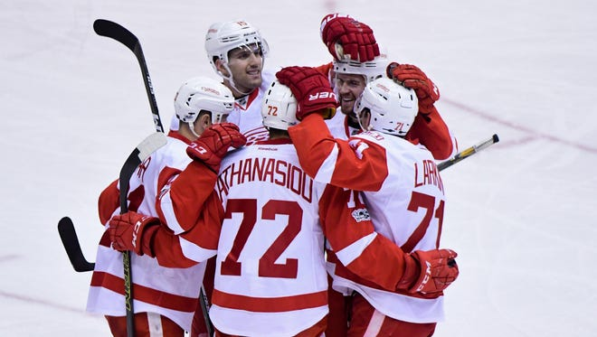 Mar 16, 2017; Glendale, AZ, USA; Red Wings center Dylan Larkin (71) celebrates with teammates after scoring a goal in the first period against the Coyotes at Gila River Arena.