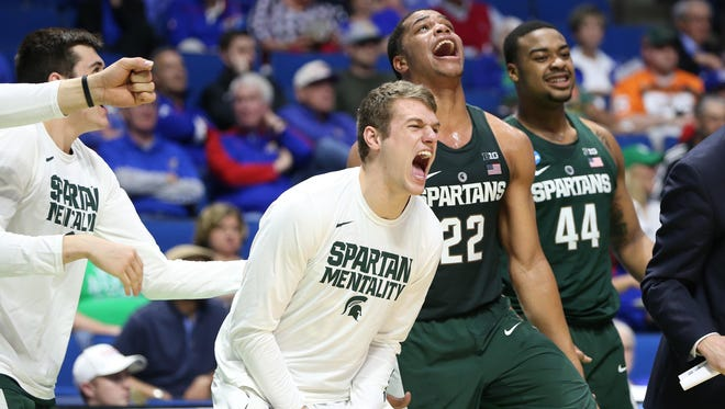 The Michigan State bench reacts during the first half of the NCAA tournament game Friday in Tulsa, Okla.