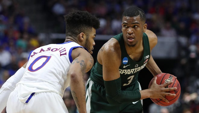 Michigan State Spartans guard Alvin Ellis III controls the ball as Kansas Jayhawks guard Frank Mason III defends during the second half of MSU's 90-70 loss in the second round of the 2017 NCAA tournament at BOK Center on March 19, 2017 in Tulsa, Okla.