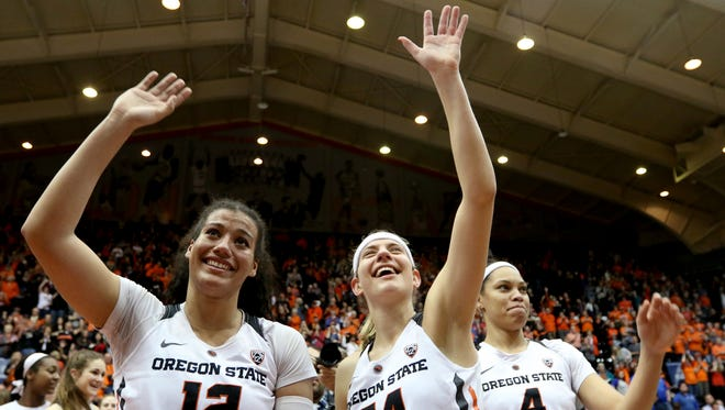 Oregon State seniors Kolbie Orum (12) and Sydney Wiese (24) and junior Breanna Brown (4) wave to the crowd following the Creighton vs. Oregon State women's basketball game in the second round of the NCAA Division I Championship in Corvallis, Ore., on Sunday, March 19, 2017. Oregon State won the game 64-52 and will go on to play Florida State on March 25.