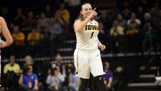 Iowa's Alexa Kastanek celebrates one of her 3-pointers during the Hawkeyes' WNIT third round game against Colorado at Carver-Hawkeyes Arena on Thursday, March 23, 2017.