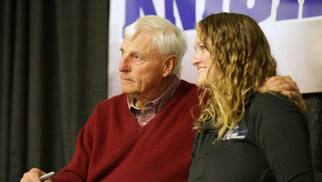 Former IU basketball coach Bobby Knight signs autographs and poses for a photo with fan, Brooke Beegle during the 58th annual Indianapolis World of Wheels, held at the Indiana State Fairgrounds, Feb. 10, 2017.