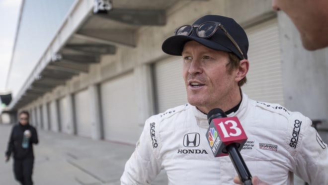 Scott Dixon talks to media during a manufacturer testing session for Verizon IndyCar series drivers at Indianapolis Motor Speedway, Indianapolis, Friday, March 24, 2017.