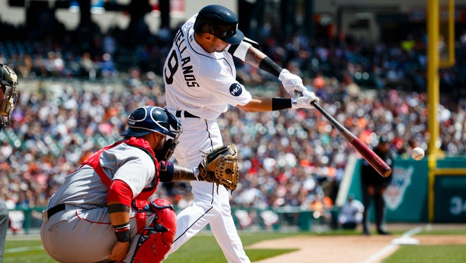 Tigers third baseman Nick Castellanos hits a single in the first inning Sunday, April 9, 2017 at Comerica Park.