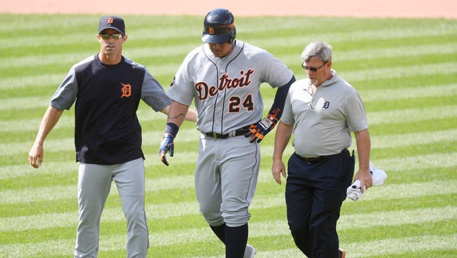 Apr 16, 2017; Cleveland, OH, USA; Tigers manager Brad Ausmus, left, helps first baseman Miguel Cabrera off the field, along with trainer Kevin Rand, in the eighth inning against the Indians at Progressive Field.