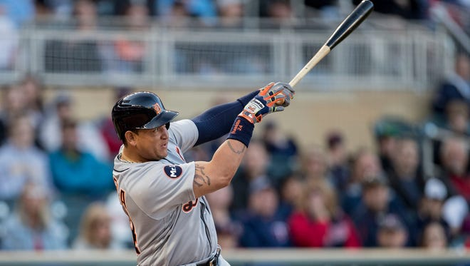 Tigers first baseman Miguel Cabrera (24) hits a single in the first inning Friday in Minneapolis.