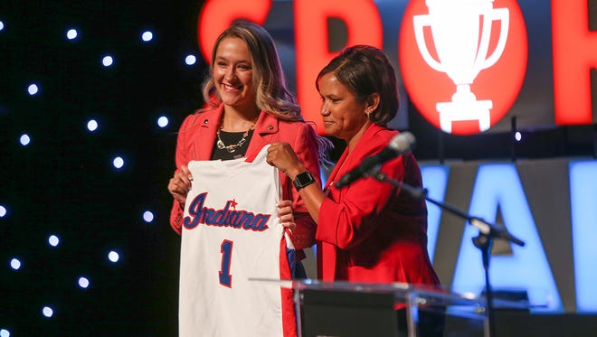 Indiana Fever Coach Pokey Chatman, right, presents the Miss Basketball jersey to Homestead's Klarissa McLaughlin at the Indiana High School Sports Awards at Clowes Memorial Hall, Indianapolis. , Thursday, April 27, 2017.