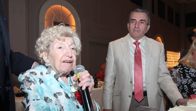 Stella Theodore Manios speaks at the birthday party. She celebrated her upcoming 100th birthday with several hundred friends and family on Sunday at St. George Greek Orthodox Church in Greenville.