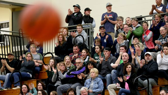 West Salem fans cheer during the first half of the Central Catholic vs. West Salem girl's basketball game, in the first round of the OSAA State Championships playoffs, at West Salem High School on Wednesday, March 1, 2017. West Salem has hired a new coach.