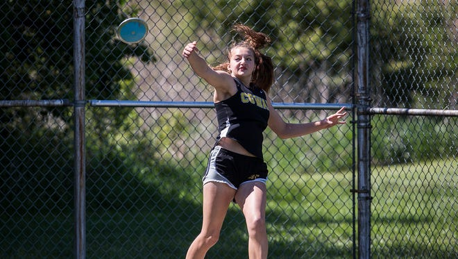 Cowan's Kaily Smith practices her throw at Cowan High School Friday, May 12, 2017.