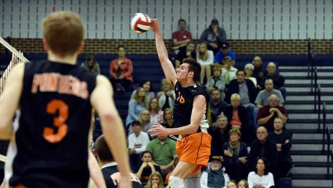 Central York's Cole Johnson spikes the ball against Central Dauphin in the first game of the PIAA District 3 Class 3A title match Thursday, May 25, 2017, at Dallastown. Central York defeated Central Dauphin 3-0 (29-27, 25-21, 25-16) to win the district championship.