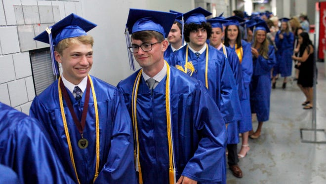 From left, Eric Kirby and Logan Kirby, both 18, no relation, prepare for the Oldham County High School commencement ceremony to begin at Broadbent Arena in Louisville.  June 3, 2017