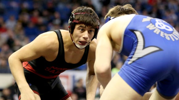 North Salem's Ian Carlos, facing, competes against McNary's Brayden Ebbs in the OSAA Wrestling State Championships Class 6A quarterfinals for weight 145 at the Memorial Coliseum in Portland on Friday, Feb. 24, 2017.