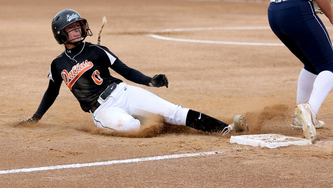 Dallas' Olivia Nelson (0) slides safely into third in the Marist Catholic vs. Dallas OSAA class 5A championship softball game at Oregon State University in Corvallis on Saturday, June 3, 2017. Marist Catholic won the championship game 12-7.