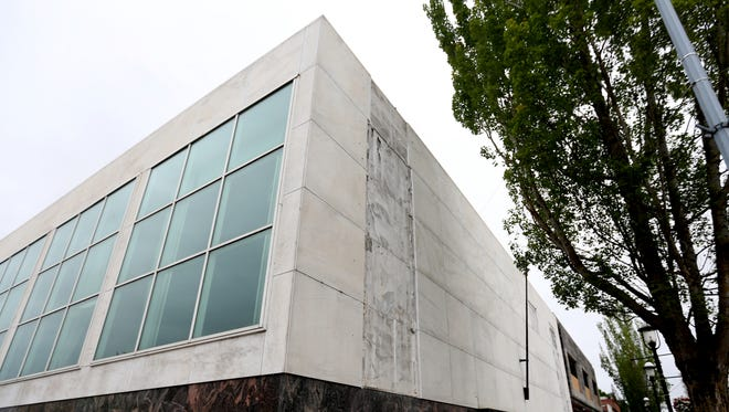 Marble panels have been removed from the building at 280 Liberty St. NE in downtown Salem. Photographed on Monday, June 12, 2017.