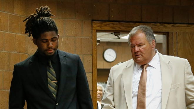 Former MSU football player Auston Robertson, left, arrives in Judge Thomas Boyd's 55th District Court room Thursday morning, June 22, 2017, with his attorney David Rosenberg for a preliminary hearing on criminal sexual conduct charges.  [MATTHEW DAE SMITH/Lansing State Journal]