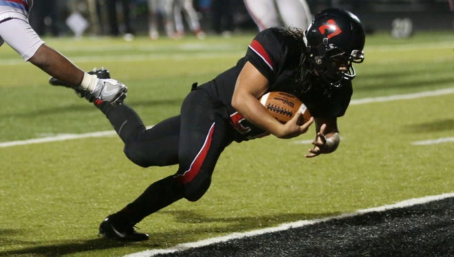 North Salem's Alexis Valenzuela (27) earns two points in the second half of the South Salem vs. North Salem football game at North Salem High School on Friday, Oct. 7, 2016. North Salem won the game 23-22.