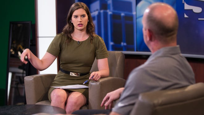 Meghan McKeown of WISH TV, interviews Purdue head football coach Jeff Brohm, on a day of television and radio station media hits during a publicity tour of Indianapolis for Purdue sports teams and football specifically, Tuesday, June 20, 2017.