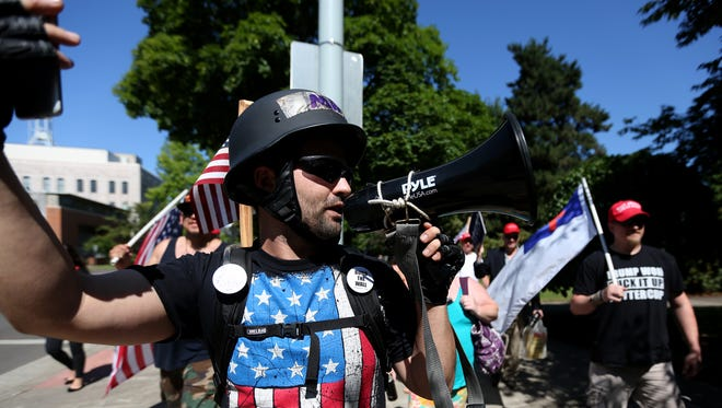 Joey Nations, 29, of Salem, leads a pro-Trump rally and march at the Oregon State Capitol in Salem in on Saturday, July 15, 2017.