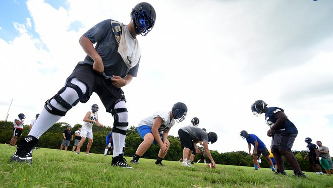 John Carroll Catholic High football players participated in portion of the Marine Corps combat fitness test Aug. 1, 2017, during their second day of practice in Fort Pierce. The school's Kickoff Classic was canceled Friday.