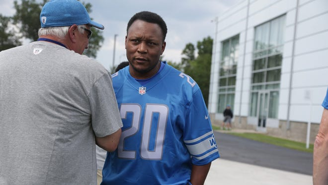 Barry Sanders is greeted as he walks onto the field during Lions training camp in Allen Park on Wednesday, Aug. 2, 2017.
