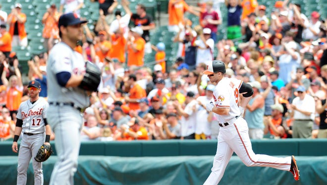 Aug 6, 2017; Baltimore, MD, USA; Orioles first baseman Chris Davis rounds the bases after hitting a home run in the first inning off Tigers starter Anibal Sanchez at Oriole Park at Camden Yards.