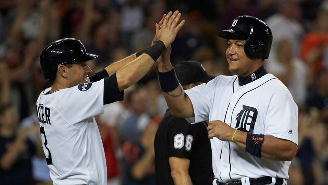 Aug 9, 2017; Detroit, MI, USA; Tigers second baseman Ian Kinsler, left, and first baseman Miguel Cabrera congratulate each other after scoring in the seventh inning against the Pirates at Comerica Park.