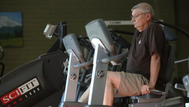Rodney Cummins, 63, does physical therapy Wednesday at Amundson Physical Therapy in Red Bluff.