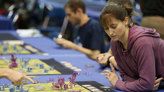 Convention-goers play tabletop games during Gen Con at the Indiana Convention Center, Indianapolis, Saturday, August 6, 2016.