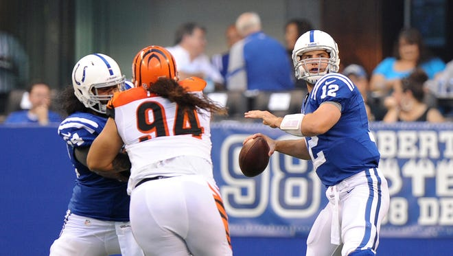 Colts quarterback Andrew Luck gets ready to launch a pass in his first and only series of play against the Bengals. The Indianapolis Colts hosted the Cincinnati Bengals at Lucas Oil Stadium in the final preseason game Thursday, August 30, 2012. (Matt Detrich / the Star)