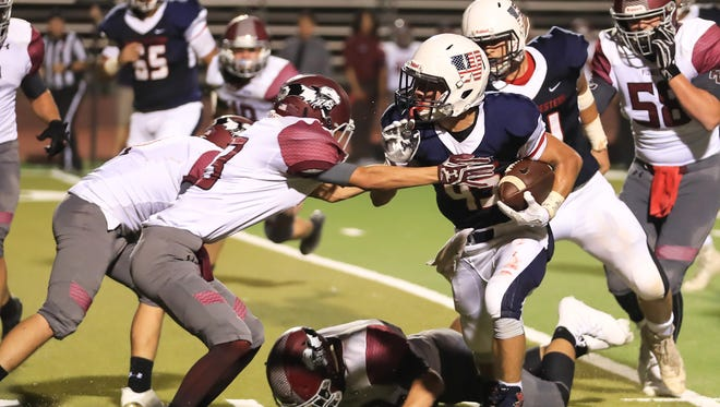Tulare Western's David Alcantar (43) rushes past Mt Whitney's Kade Kiser (13) during a non-league high school football game at Bob Mathias Stadium in Week 2 action.