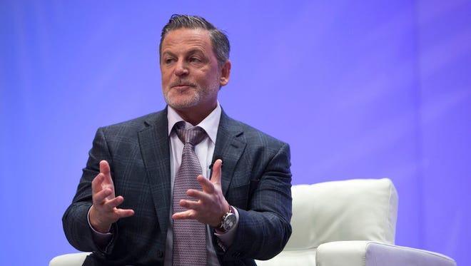 Dan Gilbert, owner of Quicken Loans and the Cleveland Cavaliers, speaks with Bloomberg's Betty Liu in January 2017 at the North American International Auto Show at Cobo Center in downtown Detroit. Dan Gilbert, the real estate icon who announced his own group Thursday to woo Amazon.