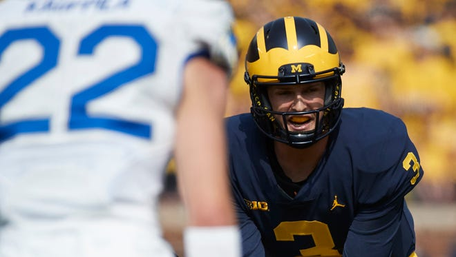 Michigan quarterback Wilton Speight takes the snap against Air Force in the first half at Michigan Stadium on Sept. 16, 2017.