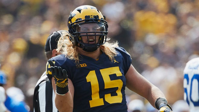 Sep 16, 2017; Ann Arbor, MI, USA; Michigan defensive end Chase Winovich celebrates a tackle in the first half against Air Force at Michigan Stadium.