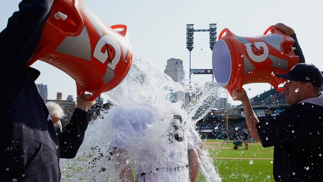 Matt Boyd is doused with water by Tigers relief pitchers Alex Wilson (left) and Warwick Saupold (right) after throwing a one-hitter against the White Sox at Comerica Park on Sunday, Sept. 17, 2017.