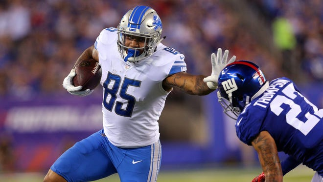 Sep 18, 2017; East Rutherford, NJ, USA; Lions tight end Eric Ebron runs with the ball against Giants safety Darian Thompson during the second quarter at MetLife Stadium.